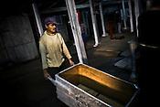 Factory worker Tarun Sarki brings the box to carry the recently dried first flush tea leaves at Makaibari Tea Estate factory, Kurseong in Darjeeling, India.