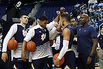 05 February 2017: Notre Dame players huddle with assistant coach Ryan Humphrey (right). The University of North Carolina Tar Heels hosted the University of Notre Dame Fighting Irish at the Greensboro Coliseum in Greensboro, North Carolina in a 2016-17 Division I Men's Basketball game. The game had been postponed one day and moved from Chapel Hill due to a water shortage. UNC won the game 83-76.