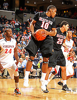 Dec. 22, 2010; Charlottesville, VA, USA; Seattle Redhawks guard Sterling Carter (10) grabs a rebound in front of Virginia Cavaliers guard K.T. Harrell (24) during the game at the John Paul Jones Arena. Seattle Redhawks won 59-53. Mandatory Credit: Andrew Shurtleff