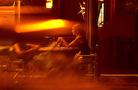 Bar patrons while the night away on Calle Honduras near the Plaza Serrano in Buenos Aires' Palermo neighborhood. In the wake of a disastrous nightclub fire that temporarily closed all the discos in the city, bars are seeing a lot of action. (Kevin Moloney for the New York Times)