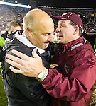 Florida State head coach Jimbo Fisher, right, and Boston College head coach Steve Addazion meet at mid field after  an NCAA college football game in Tallahassee, Fla., Saturday, Nov. 22, 2014.  Florida State defeated Boston College 20-17.  (AP Photo/Mark Wallheiser)