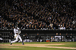"CHICAGO - October 5:  Alexei Ramirez #10 of the Chicago White Sox bats while 40,142 White Sox fans participate in a ""rolling blackout""  during the game against the Tampa Bay Rays at U.S. Cellular Field in Chicago, Illinois on October 5, 2008.  The White Sox defeated the Rays 5-3. (Photo by Ron Vesely)"