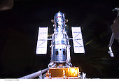 In Earth Orbit - May 19, 2009 -- A final look at the Hubble Space Telescope prior to its release on May 19, 2009 following a full week's work. Atlantis' remote manipulator system arm, instrumental in last week's capture and the impending release of the giant orbital observatory, is at the right edge of the frame..Credit: NASA via CNP