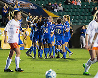 Number one seed Virginia and number two seed UCLA play in the the NCAA Division I Soccer Tournament semifinals at Wakemed Soccer Park in Cary, NC on December 6, 2013.  UCLA celebrates Ally Courtnall's (42) goal.