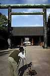 A man takes a photo in front of the main gate at Yasukuni Shrine in Tokyo, Japan. very year on August 15, the day Japan officially surrendered in WWII, tens of thousands of Japanese visit the controversial shrine to pay their respects to the 2.46 million war dead enshrined there, the majority of which are soldiers and others killed in WWII and including 14 Class A convicted war criminals, such as Japan's war-time prime minister Hideki Tojo. Each year speculation escalates as to whether the country's political leaders will visit the shrine, the last to do so being Junichiro Koizumi in 2005. Nationalism in Japan is reportedly on the rise, while sentiment against the nation by countries that suffered from Japan's wartime brutality, such as China, has been further aggravated by Japan's insistence on glossing over its wartime atrocities in school text books...Photographer:Robert Gilhooly....Photographer:Robert Gilhooly