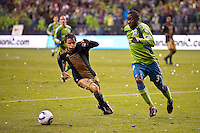 Roger Torres (l) and Jhon Kennedy Hurtado (34) go after the ball as the Seattle Sounders defeated the Philadelphia Union, 2-0, in an MLS match on Thursday, March 25, 2010 at Qwest Field in Seattle, WA. It was the Sounders home opener and the first regular season game for the expansion Philadelphia Union.