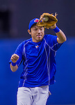 4 April 2015: Toronto Blue Jays infielder Munenori Kawasaki warms up prior to an exhibition game against the Cincinnati Reds at Olympic Stadium in Montreal, Quebec, Canada. The Blue Jays defeated the Reds 9-1 in the second of two MLB weekend exhibition games. Mandatory Credit: Ed Wolfstein Photo *** RAW (NEF) Image File Available ***