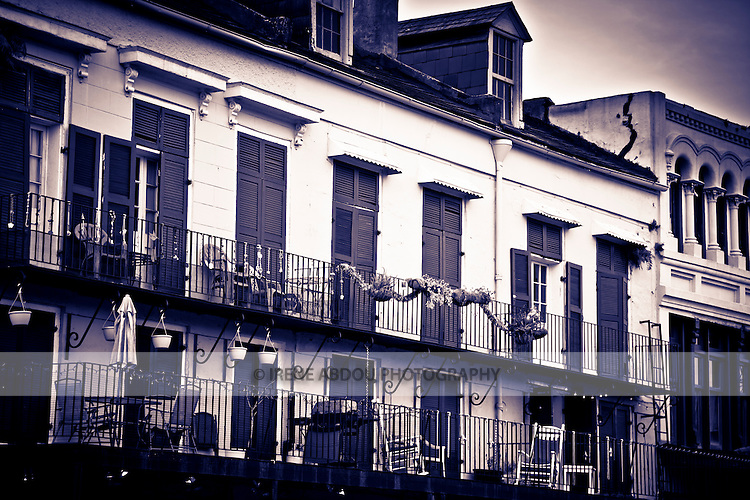 The Spanish-style architecture of the French Quarter of New Orleans, Louisiana dates back hundreds of years to the 1700s.  It is distinctive for the intricate, wrought iron balconies, central courtyards, and quaint doors and windows.  Many balconies display Mardi Gras beads, which are collected by residents each year, as they are thrown by krewes from parade floats.