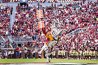 TALLAHASSEE, FLA 9/10/16-Florida State student Brendan Carter portrays the Seminole mascot Osceola and plants the spear at midfield while riding Renegade prior to the 2016 home opener against Charleston Southern Saturday at Doak Campbell Stadium in Tallahassee. <br /> COLIN HACKLEY PHOTO