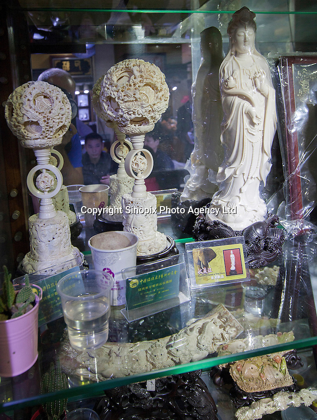 Ivory is seen on sale in an officially licenced retail outlet, as authorised by China's State Forestry Administration, Li Wan District, Guangzhou, Guangdong Province, China, 28 November 2013. <br /> <br /> Photo by Alex Hofford / Sinopix