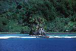 Ship wreck on the beach against background of palm covered rocks and green covered cliffs,  Pago Pago, American Samoa 1980