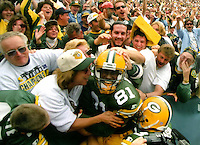 Desmond Howard does a Lambeau Leap after a 65-yard punt return for a touchdown in the fourth quarter as the Packers defeated the San Diego Chargers 42-10 on September 15, 1996.