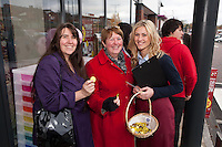Jessica Salt hands out welcome chocolates to the first two in the queue, Rachel Gasgoyne (left) and Julie Toms