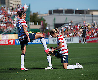"Carli Lloyd (10) of the USWNT has her shoes ""shined"" by teammate Heather Mitts (2) after she scored a goal during a friendly match at Sahlen's Stadium in Rochester, NY.  The USWNT defeated Costa Rica, 8-0."