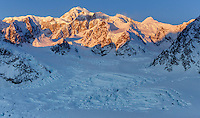Winter landscape of first light on the summit of Denali (Mt. Mckinley) with glaciers and other Alaska Range Mountains below. Denali National Park, Alaska<br /> <br /> Photo by Jeff Schultz/SchultzPhoto.com  (C) 2017  ALL RIGHTS RESVERVED