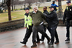"A man was arrested for assaulting a police officer Tuesday during the 'Occupy Congress"" protests on Capitol Hill. Hundreds of protestors with the Occupy movements gathered outside the Capitol, waving signs and chanting against a barrier of police."