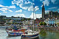 Popular as a tourist destination Cobh harbour with brightly coloured fishing boats in County Cork, Ireland