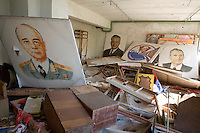 Palace of Culture Theatre prop room with paintings of Lenin and dignatories.<br />