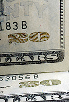 OPTICAL SECURITY FEATURES ON U.S. CURRENCY<br /> Color Changing Ink On Twenty Dollar Bill. The numeral 20 in the lower-right corner on the face of the note changes from copper to green when the note is tilted.