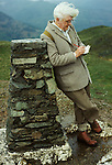 Portrait of the writer and artist Alfred Wainwright in the Lake District, Cumbria, England. Circa 1970. Summit of Loughrigg trig point.