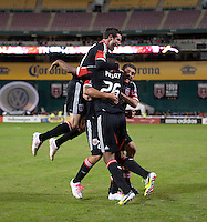 Nick DeLeon (18) of D.C. United celebrates his goal with teammates Lionard Pajoy (26), Chris Pontius (13), and Chris Korb (22) during the game at RFK Stadium in Washington, DC.  D.C. United defeated the Columbus Crew, 3-2.