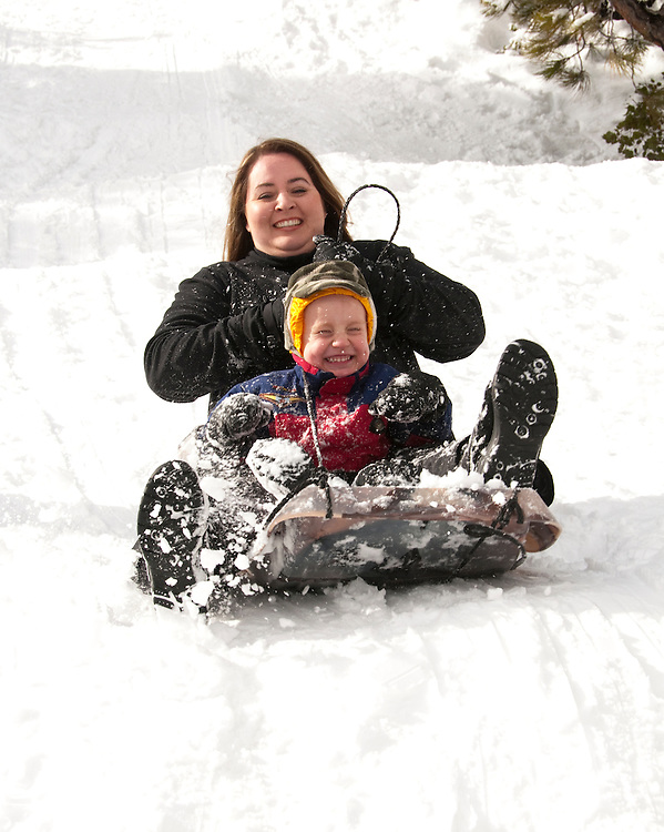 California, Lake Tahoe: Child and mother enjoy snow play with sled at North Lake Tahoe Regional Park.  Photo copyright Lee Foster.  Photo # cataho107686