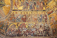 The Medieval mosaics of the ceiling of The Baptistry of Florence Duomo ( Battistero di San Giovanni ) showing the Apostles seated above scenes from the Last Judgement,  started in 1225 by Venetian craftsmen in a Byzantine style and completed in the 14th century. Florence Italy