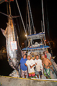 Bomboy Llanes with boat crew and Angler Jen Brookes and husband Evan with Pacific Blue Marlin Grander