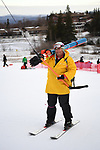 FRANCONIA, NH - MARCH 10:   A volunteer carries a stack of slalom gates prior to the Slalom event at the Division I Men's and Women's Skiing Championships held at Cannon Mountain on March 10, 2017 in Franconia, New Hampshire. (Photo by Gil Talbot/NCAA Photos via Getty Images)