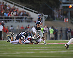 Ole Miss quarterback Randall Mackey (1) is tackled by Alabama defensive lineman Nick Gentry (58)and Alabama defensive back DeQuan Menzie (24) as Ole Miss' Bradley Sowell (78) blocks at Vaught-Hemingway Stadium in Oxford, Miss. on Saturday, October 14, 2011. Alabama won 52-7.