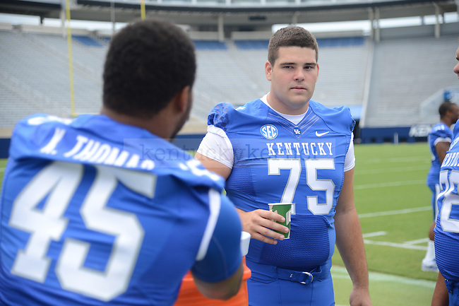 Lexington native, Zach West, stares down fellow teammate Pancho Thomas at UK Football Media Day on Friday, August 3, 2012. Photo by Mike Weaver  Staff