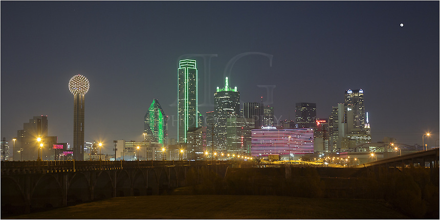 Taken between two levees crossing the Trinity River, this Dallas skyline panorama shows the downtown area at night with a full moon rising. The area this Dallas image was captured from is not in the best part of town, so if you venture here, take a friend (or two or three). Still, it offers one of the best views of the downtown area.