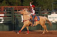Rodeo Queen at the Riata Roundup June 8th near dusk, and inside the arena.
