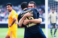 Pumas players Dante Lopez (R ) and Eduardo Herrera (15) celebrates their goal against Tigres during their match between Pumas VS Tigres both teams were tied at two goals. Photo by Miguel Angel Pantaleon/VIEWpress