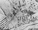 Somewhere in North Korea -- Numerous barrack type buildings pictured in this aerial photo made from an Air Force RB-29 reconnaissance aircraft indicate the area could be used as a Prisoner of War camp, named by the Communists to exist at Pukchin, but again, visible markings are not seen. March 1952.
