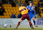 St Johnstone v Motherwell....26.01.11  .Stevie May is blocked by Stephen Craigan.Picture by Graeme Hart..Copyright Perthshire Picture Agency.Tel: 01738 623350  Mobile: 07990 594431