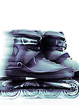 Closeup of inline skates, rollerblades artistic dynamic still life with motion blur isolated on white background