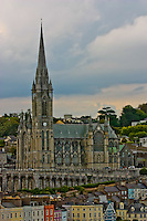 A beautiful Irish church stands out in the town viewed from a cruise ship.