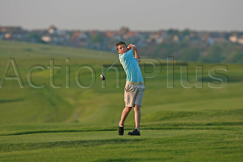 Model Released Image. A teenage golfer looks into the distance after playing a tee shot at East Brighton Golf Club, Brighton, East Sussex, England. Photo: Steve Bardens/actionplus...golf club children child boy teenager male recreation leisure youth plays tees