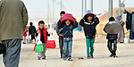 Boys carry buckets and basins in the Zaatari Refugee Camp, located near Mafraq, Jordan. Opened in July, 2012, the camp holds upwards of 50,000 refugees from the civil war inside Syria, but its numbers are growing. International Orthodox Christian Charities and other members of the ACT Alliance are active in the camp providing essential items and services.