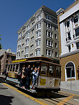 Cable car goes down a hill in San Francisco
