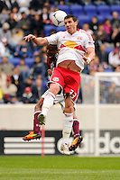 Kenny Cooper (33) of the New York Red Bulls goes up for a header. The New York Red Bulls defeated the Colorado Rapids 4-1 during a Major League Soccer (MLS) match at Red Bull Arena in Harrison, NJ, on March 25, 2012.
