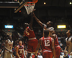 "Arkansas' Glenn Bryant (5) and Ole Miss guard Nick Williams (20) go for the ball at C.M. ""Tad"" Smith in Oxford, Miss. on Saturday, March 5, 2010. Mississippi won 84-74."