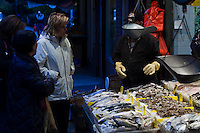 People buy fresh fish at Manhattan's Chinatown in New York, Nov 11, 2013. VIEWpress/Eduardo Munoz Alvarez