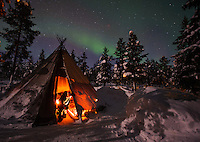 Northern Lights above tents at the reindeer lodge in Jukkasjärvi, Sweden