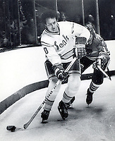 Seals Bob Murdoch chased by Chicago's Keith Magnuson. photo/Ron Riesterer
