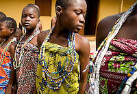 Young girls from the Krobo tribal group stand in line wearing traditional beads as they undergo puberty rites - locally called dipo - in Somanya, Eastern Region, Ghana.