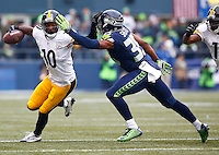 Martavis Bryant #10 of the Pittsburgh Steelers attempts to shed a tackle by DeShawn Shead #35 of the Seattle Seahawks after catching a pass in the first half during the game at CenturyLink Field on November 29, 2015 in Seattle, Washington. (Photo by Jared Wickerham/DKPittsburghSports)