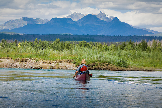 Canoe on the North Fork of the Flathead River in Montana looking at the MacDonald Mountain Range in Glacier National Park