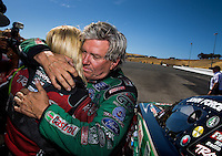 Jul. 27, 2014; Sonoma, CA, USA; NHRA funny car driver John Force (right) hugs daughter Courtney Force as she celebrates after winning the Sonoma Nationals at Sonoma Raceway. Mandatory Credit: Mark J. Rebilas-